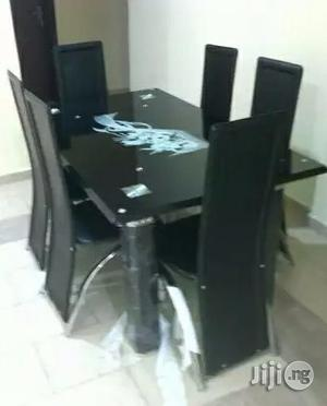 Flashy 6-sitter Glass Dining Table