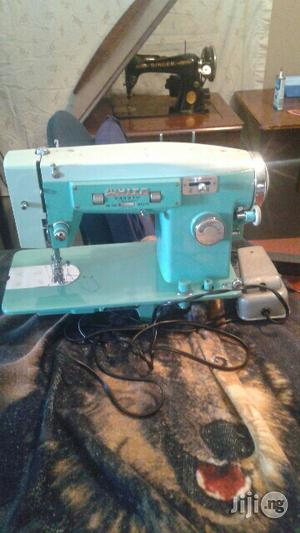 Electric And Manual Sewing Machines