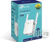Tplink Dual Band 2.4ghz 867mbps/5ghz 300mbps Wifi Range Extender RE305 | Networking Products for sale in Lagos State, Ikeja