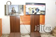 We RENT 60 Inch Smart LED TV With Wooden Stand For Exhibition In Lagos | Furniture for sale in Lagos State, Ikeja