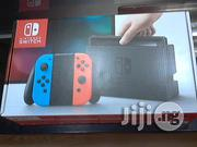 Console Nintendo Switch Neon Red Blue 32gb Original | Video Game Consoles for sale in Lagos State, Ikeja