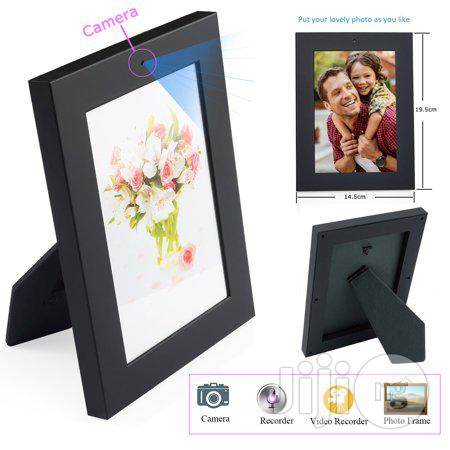 Photo Frame With Hidden Camera And Motion Detection