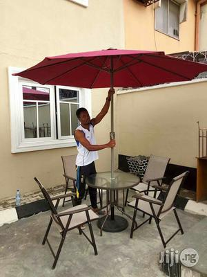 Outdoor Umbrella and Tables