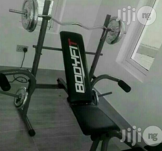 Weight Bench With 50kg Plate and Barbell