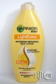 Garnier Light Extra Whitening Repairing Milk Lotion | Skin Care for sale in Lagos State, Amuwo-Odofin