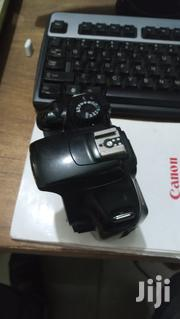 Canon 1100d Body Only With A Charger An A Battery | Photo & Video Cameras for sale in Lagos State, Surulere