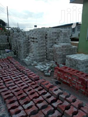 Production And Installation Of Kerbs And Interlocking Paving Stones