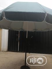 Modern Stand With Customized Branded Parasol Umbrella | Manufacturing Services for sale in Ekiti State, Emure