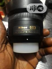 This Is 35mm Nikon Lens Pain Lens 1.8g Is Very Bright And Sharp | Accessories & Supplies for Electronics for sale in Lagos State, Ikeja