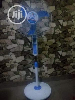Rechargeable Solar Energy Standing Fan With Its Panel.
