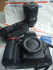 Nikon D7100 With 18-200mm Lens Battery and Charger | Accessories & Supplies for Electronics for sale in Edo State, Ikpoba-Okha