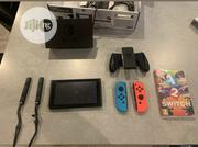 Nintendo Switch With Neon Blue And Neon Red Joy‐Con - HAC-001(-01) | Video Game Consoles for sale in Lagos State, Ikeja