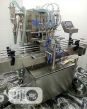 Automatic Linear Bottle Liquid Yoghurt Filling Machine 4 Nozzles | Manufacturing Equipment for sale in Lagos State, Apapa