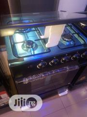 Midea Gas Cooker 4burners With Oven And Grill Automatic Blue Flame | Restaurant & Catering Equipment for sale in Lagos State, Ojo
