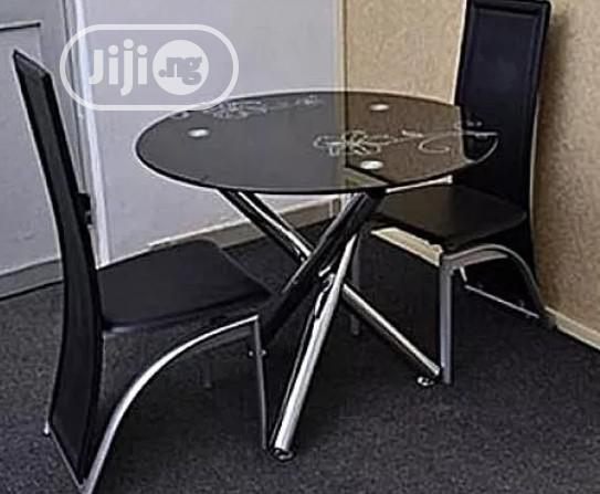 Quality 4 Seaters Round Glass Dining Table