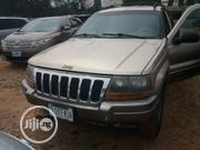 Jeep Grand Cherokee 2001 Gold | Cars for sale in Abuja (FCT) State, Central Business District