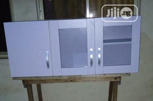 A Brand New White Kitchen/Dinning Cabinet With Glass Doors