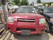 Nissan Frontier 2004 SVE V6 King Cab 4WD Red | Cars for sale in Lagos State, Amuwo-Odofin