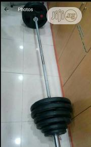 Olympic Weight With Barbell   Sports Equipment for sale in Lagos State, Ikeja