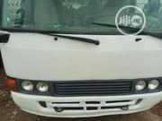 Neatly Used Toyota Coaster 2004 White | Buses & Microbuses for sale in Abuja (FCT) State, Garki 2