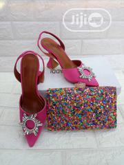 Female Pink Clutch With Heel Half Shoe | Shoes for sale in Lagos State, Amuwo-Odofin