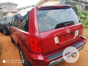 Honda Pilot 2004 EX-L 4x4 (3.5L 6cyl 5A) Red | Cars for sale in Lagos State, Ifako-Ijaiye
