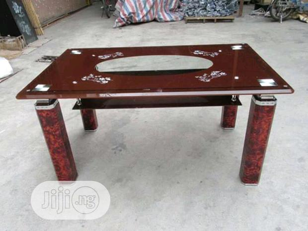 Paded Brown Glass Table