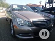 Mercedes-Benz C300 2012 Gold | Cars for sale in Abuja (FCT) State, Jabi