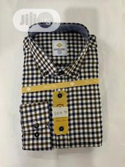 Quality Men's Designers Check Shirt In Black And Yellow Strips | Clothing for sale in Lagos State, Lagos Island