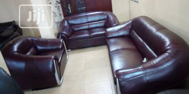 JH-306: Six Seater Brown Leather Settee
