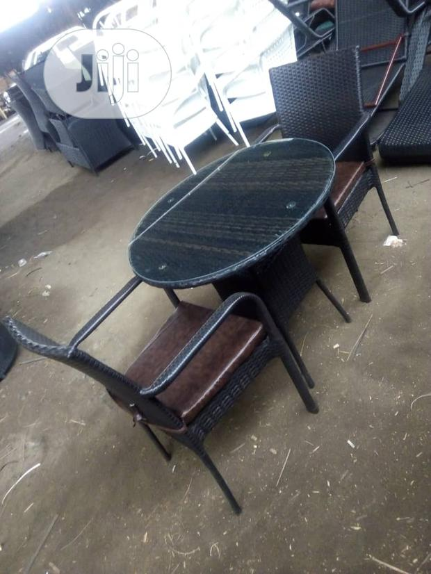 Rattan Chair And Table With Leather Sit