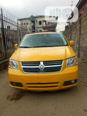 Dodge Caravan 2010 Yellow | Cars for sale in Lagos State, Mushin