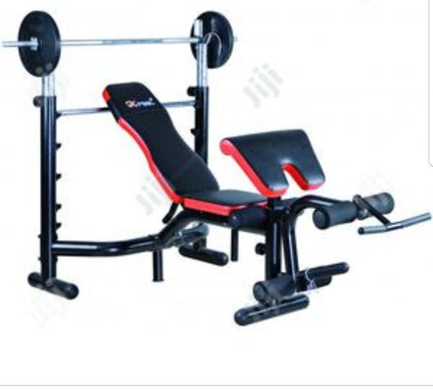 Deluxe Weight Bench and 50kg + Barbell