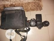 Nikon D3500 Camera With KIT Lens + Bag + Speedlight | Photo & Video Cameras for sale in Lagos State, Ikeja