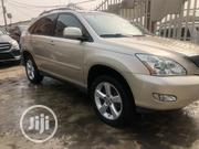 Lexus RX 2005 330 4WD Gold | Cars for sale in Lagos State, Ikeja