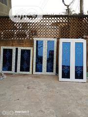Casement Widown Wth Flower Glass Blue Reflective Glass Double Glazzing | Windows for sale in Lagos State, Agege