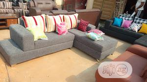 L Shape Sofa Chair With Throw Pillow for Your Sitting Room.