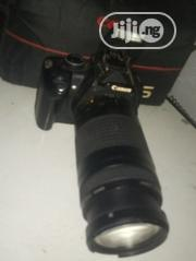 Neatly Used Canon Eos 350d With 75-300mm Lens | Photo & Video Cameras for sale in Ebonyi State, Abakaliki