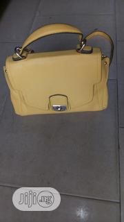 Ladies Trendy Yellow Handbag | Bags for sale in Lagos State, Isolo