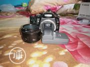 Used Canon 400D With Battery Charger And 50mm F1.8 Canon Lenz | Photo & Video Cameras for sale in Enugu State, Enugu