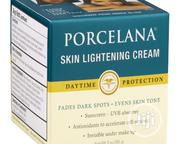 Porcelana Skin Lightening Day Cream And Fade Dark Spots Treatment, 3oz | Skin Care for sale in Lagos State, Ajah