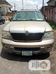 Lincoln Navigator 2004 4x4 Luxury Gold | Cars for sale in Lagos State, Surulere