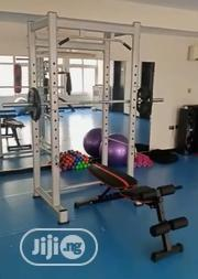 Squat Rack With Adjustable Bench +Olympic Bar +20kg Weight | Sports Equipment for sale in Lagos State, Surulere