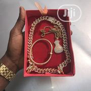Crystal Iced Cuban Choker With Money Bag Pendant and Nail Bracelet   Jewelry for sale in Lagos State, Lagos Island