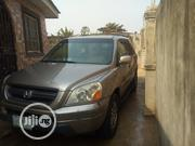 Honda Pilot 2004 EX-L 4x4 (3.5L 6cyl 5A) Gold | Cars for sale in Lagos State, Alimosho