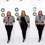 New Quality Female Turkey Strip Jacket and Black Jumpsuit | Clothing for sale in Lagos State, Victoria Island