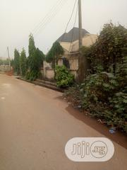 Level Plot Of Land Measuring 60X100FT Fenced Road On A Tarred Road | Land & Plots For Sale for sale in Edo State, Benin City