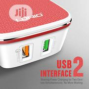 LDNIO A2405Q US Plug White And Red Color Dual USB Wall Charger With On | Accessories & Supplies for Electronics for sale in Lagos State, Ikeja