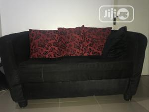 A Very Neatly Used Couch With 3 Throw Pillows