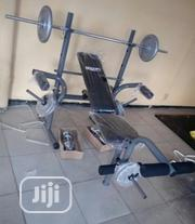 Imported Weight Bench With With 50kg Weight Plate And Barbell | Sports Equipment for sale in Lagos State, Magodo